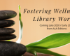 "image of 5 dark flat rocks stacked on top of each other with leaves in the background. ""Fostering Wellness in the Library Workplace"" ""Coming late 2020/early 2021 from ALA editions"""